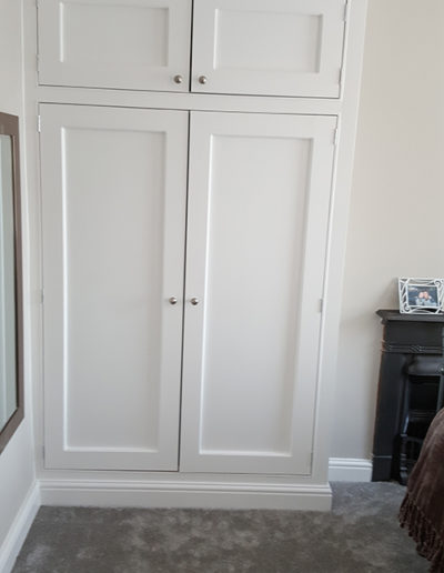 Carpentry work to create a bespoke fitted wardrobe, painting & decorating to rest of room