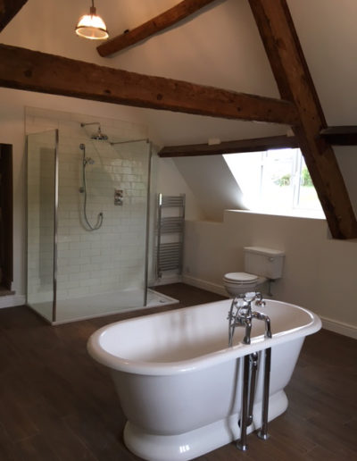 Interior painting & decorating to a bathroom with original beams